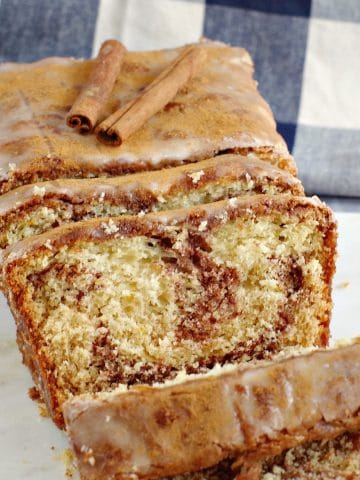 Sliced cinnamon swirl bread on a marble board