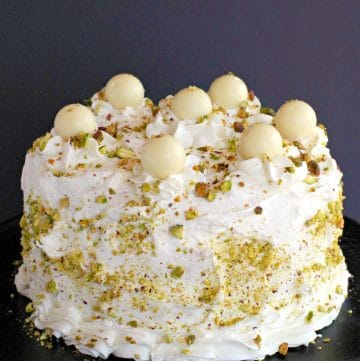 White Chocolate Pistachio cake on black stand