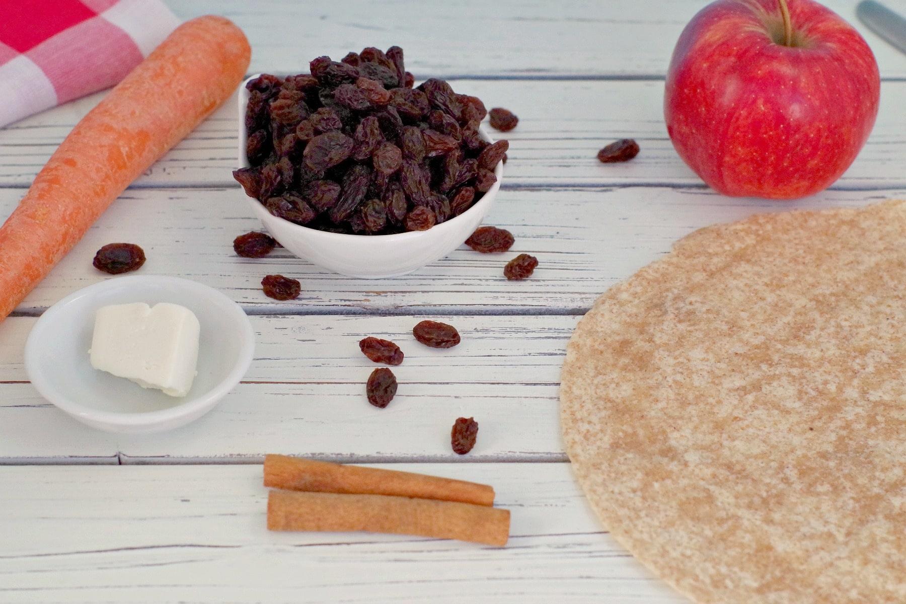 apple, raisins, cinnamon sticks, carrot, cream cheese and whole wheat tortillas