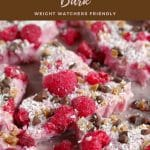 pinterest pin with pink text or brown background and photo offrozen yogurt bark broken into pieces