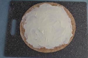 cream cheese spread on tortilla