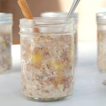 Bananas Foster Overnight Oats in a jar with more in background