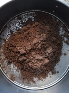 chocolate crumbs poured into springform pan