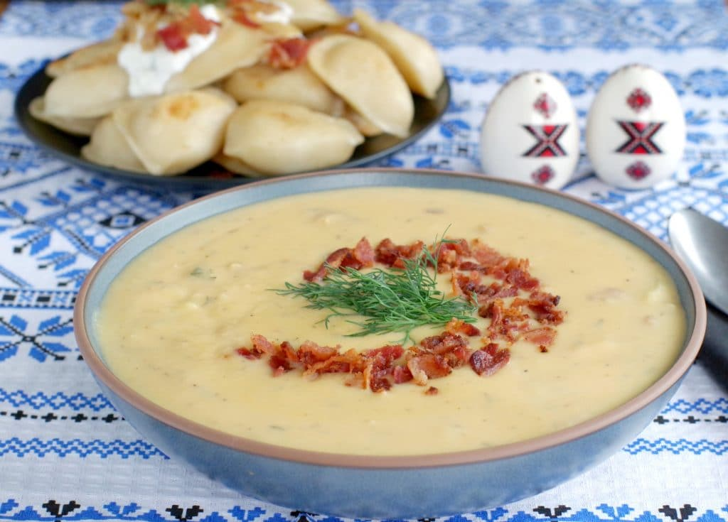 Loaded Pierogi soup with a plate of loaded pierogies in the background