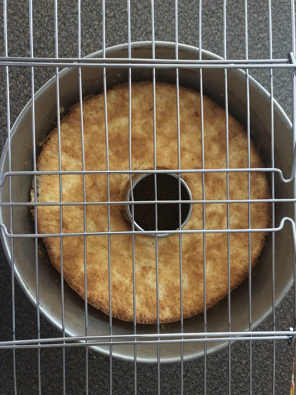 cooling rack on cake pan in preparation to flip