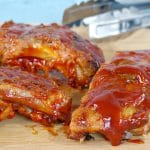 slow cooker BBQ beer ribs on a cutting board