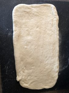 dough rolled in large rectangle