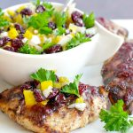 grilled chicken on white tray will salsa in white dish in background