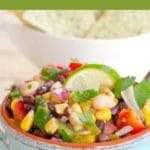 Pinterest pin with white text on green background on top and bottom and photo of texas caviar dip in the middle