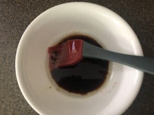 oil and balsamic vinegar mixed together in white bowl