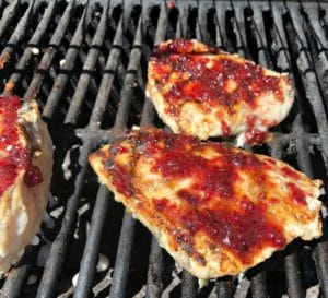 cranberry glaze on chicken on grill