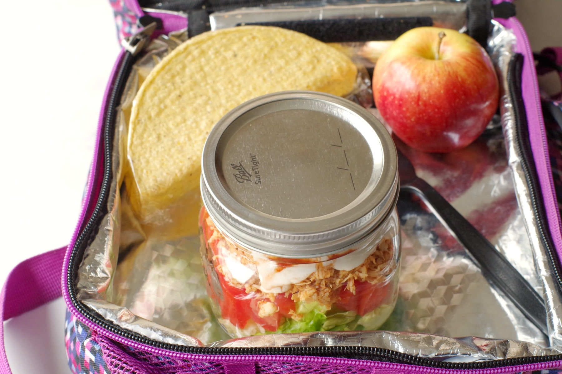 mason jar chicken taco salad in lunch bag with taco shell and apple