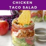 pin with text and photo of no cook chicken taco salad in a mason jar with apple and lunch bag in background