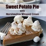 Pinterest pin with text in the middle and photo of a piece of Sweet Potato Pie with Marshmallow Whipped Cream on Black plate on blue background with whole pie in glass pie plate in the background