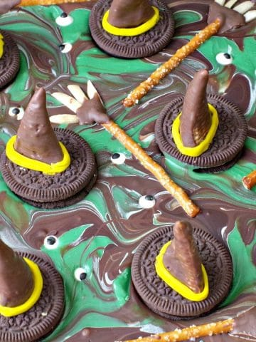 melting witches Halloween Chocolate Bark- edible witch hats and brooms on melted witch puddles