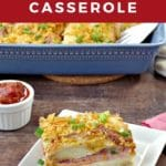 Pinterest pin with text on top and bottom and photo of a slice of Christmas morning casserole on a white plate, on brown wooden surface, with fork on red napkin beside it, salsa in a white dish behind and a blue casserole dish with remaining casserole in it
