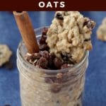 raisin cookie oatmeal in a jar with cookie on top and cinnamon stick on blue background with raisin oatmeal cookies in background