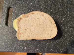 sandwich put together on cutting board