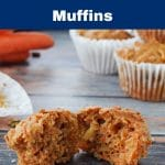 Pinterest pin with light grey text on dark blue background on top and bottom and photo of carrot muffin on blue wood-like surface, pulled into 2 pieces , with wrapper, more muffins and carrots in background