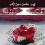 Pinterest pin with white text on brown background on top and bottom and photo of a mini cherry cheesecake on a damask print muffin wrapper, with a red speckled muffin tin ofmini cherry cheesecakes in the background