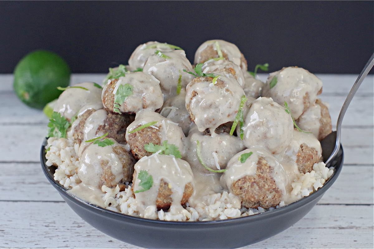 turkey meatballs with rice in black bowl