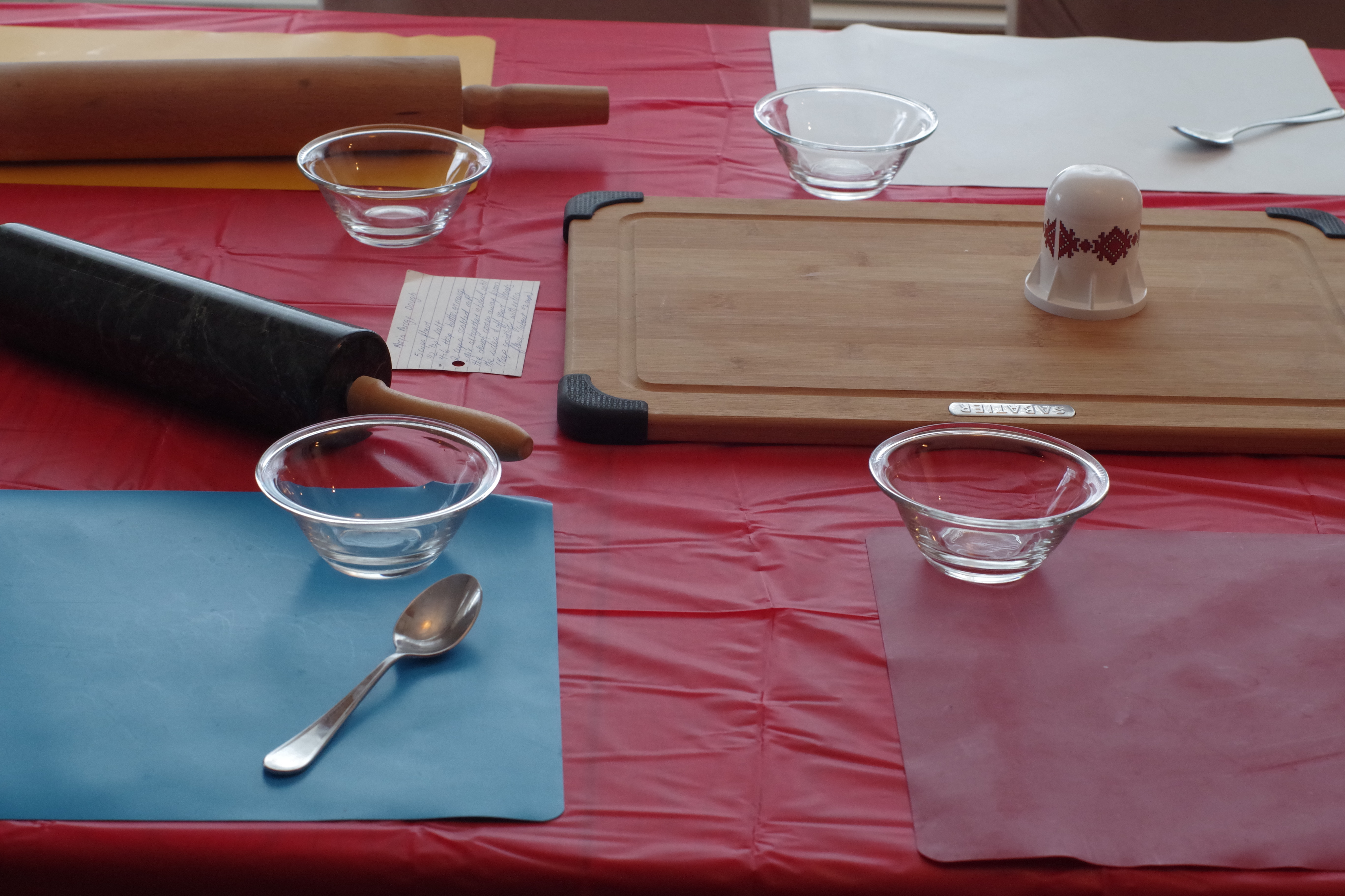 table set up for perogy party with cutting board, rolling pins etc..