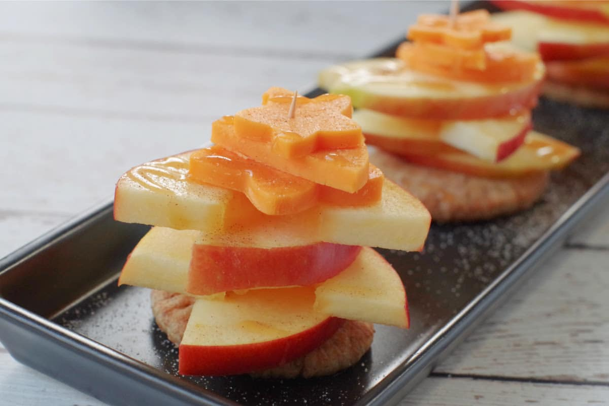 caramel apple pie bites on a narrow black tray