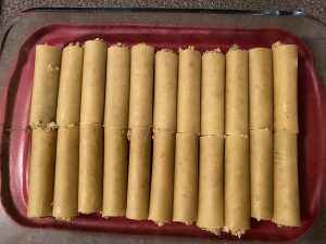 cannelloni tubes laying in a glass container