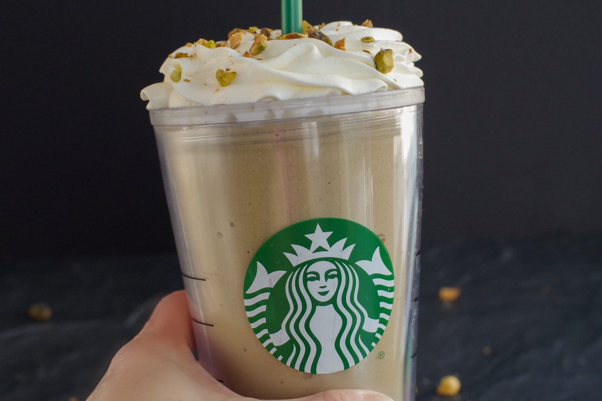 Starbucks Copycat Pistachio Frappuccino being held up by a hand