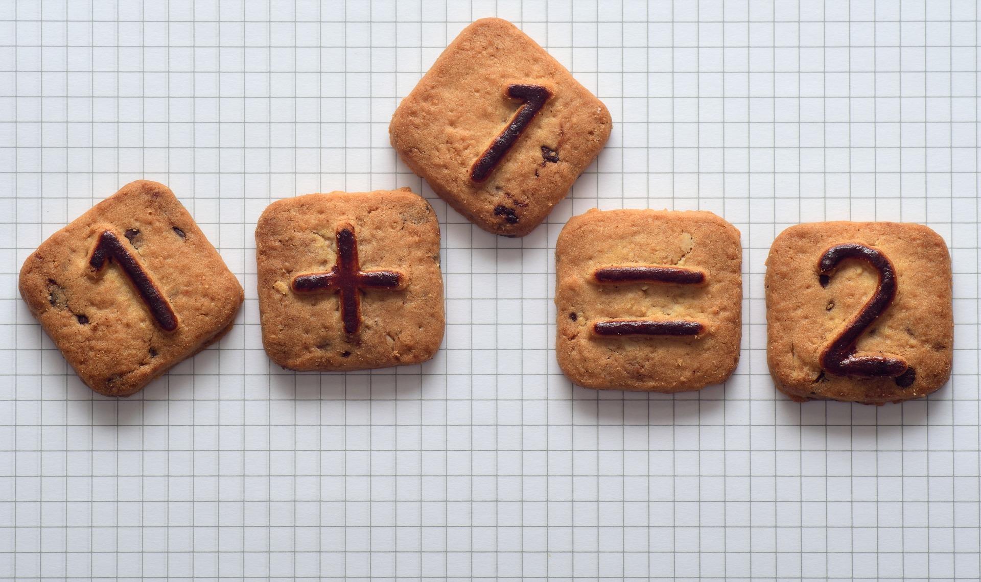 1+1 = 2 written on crackers