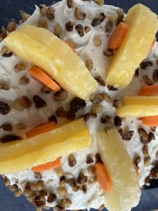 carrots and pineapple topping on cake