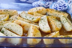 greek style potatoes in a glass dish