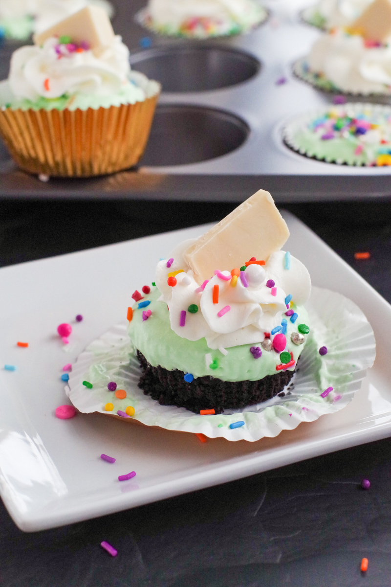 ice cream cupcake on a white plate with muffin tin in the background