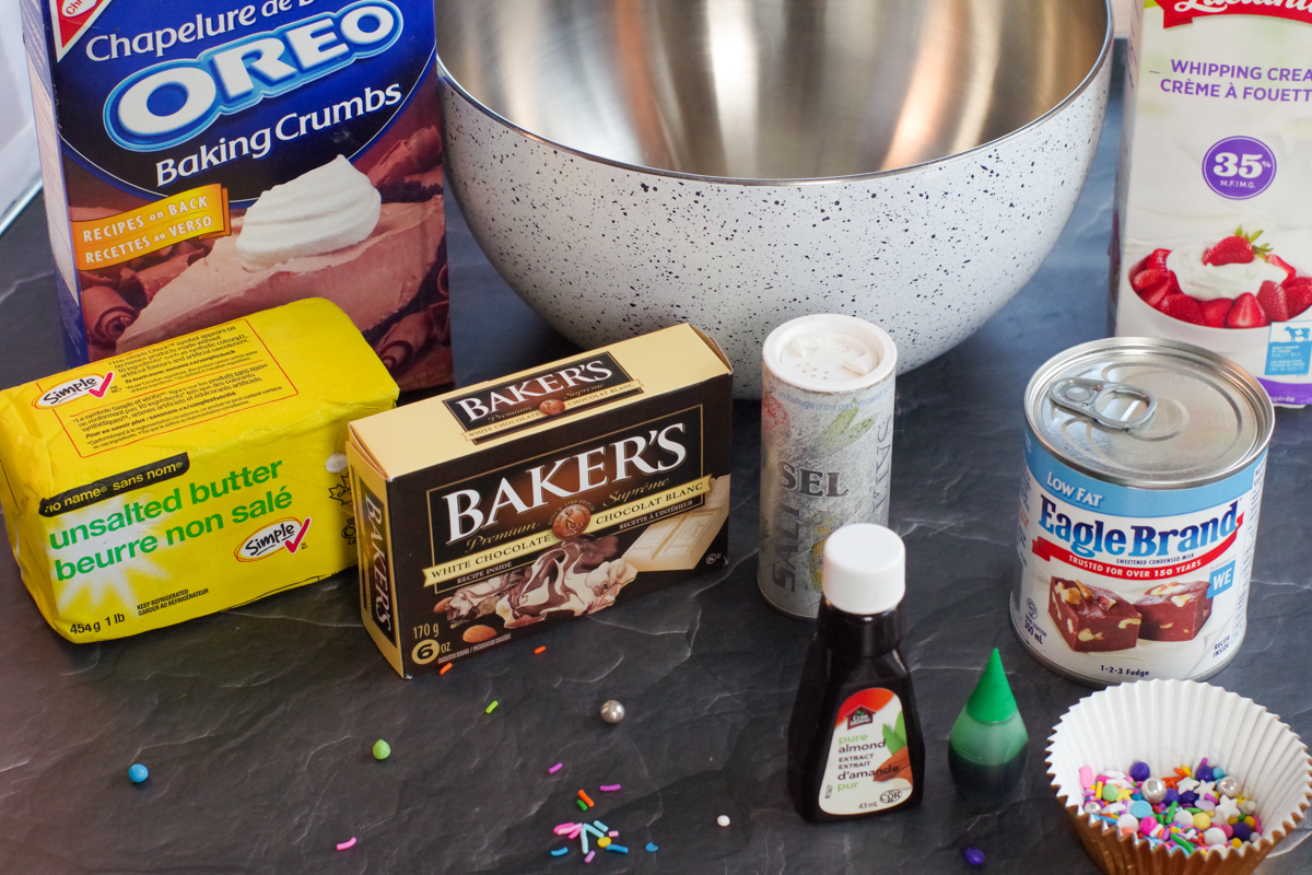 Ingredients in no churn ice cream cupcakes on black surface