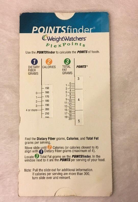 weight watchers slider on a beige surface