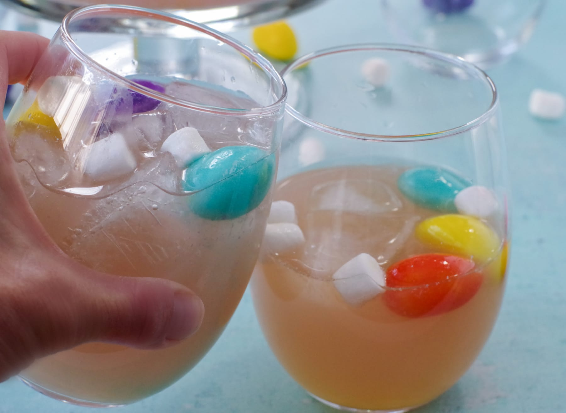 2 glasses with Easter punch clinking together