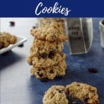 pinterest pin with white text on blue background on top and bottom and photo of oatmeal raisin cookie broken in half and a stack of cookies in background, on blue surface