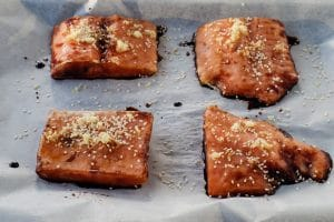 frozen salmon fillets with soy sauce, ginger and sesame seeds