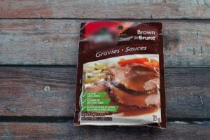package of instant gravy on a wooden surface