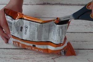 tortilla chips bag being cut open
