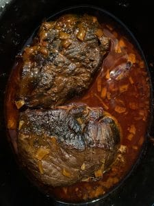 cooked meat with sauce in slow cooker