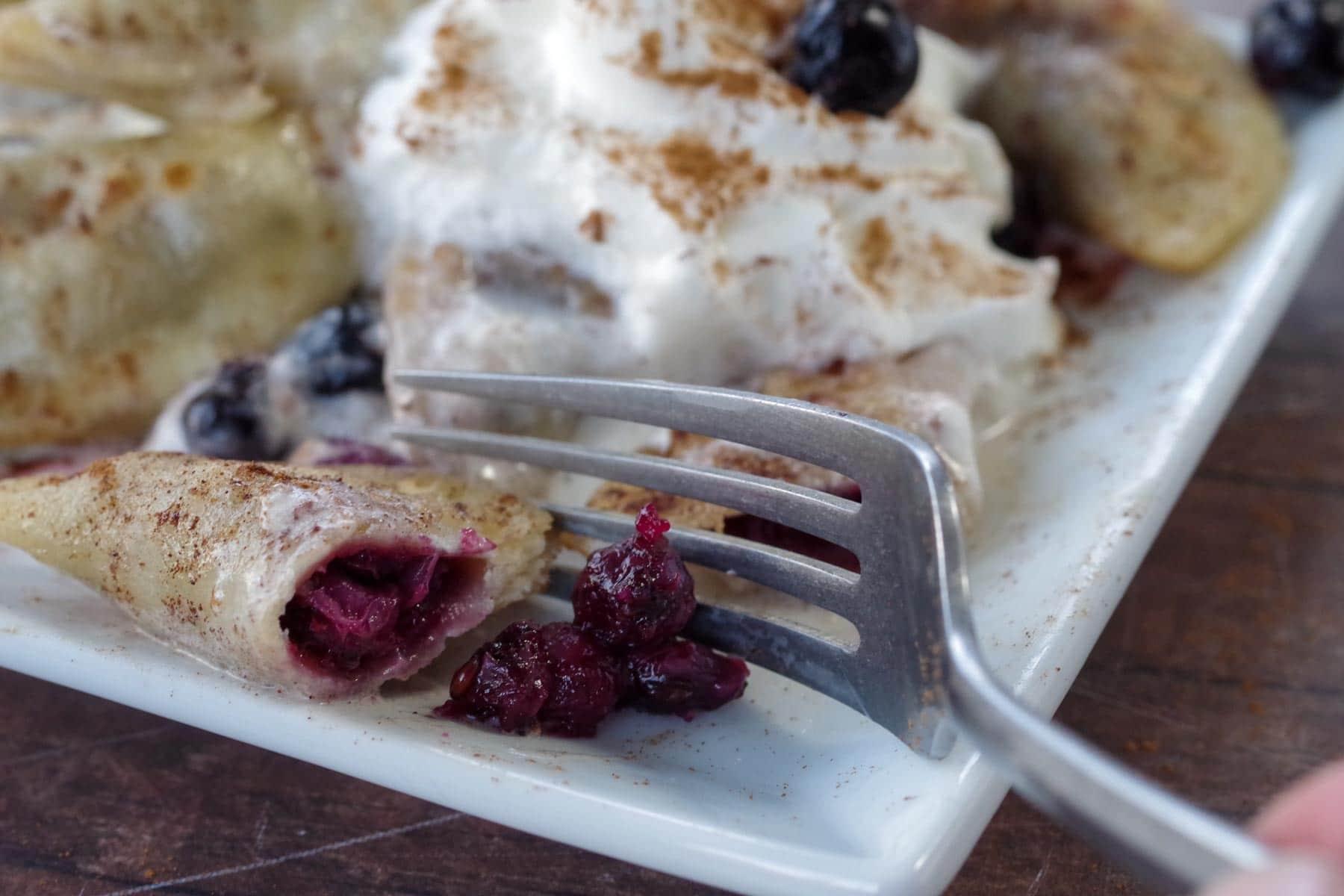 fork cutting into Saskatoon berry perogies