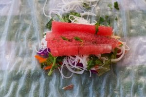 salad roll ingredients and watermelon on rice paper wrapper