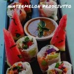 pinterest pin with white text on photo of vietnamese salad rolls and dip with wedges of watermelon on a black tray
