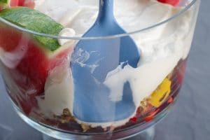 spatula pushing back trifle to make room for watermelon