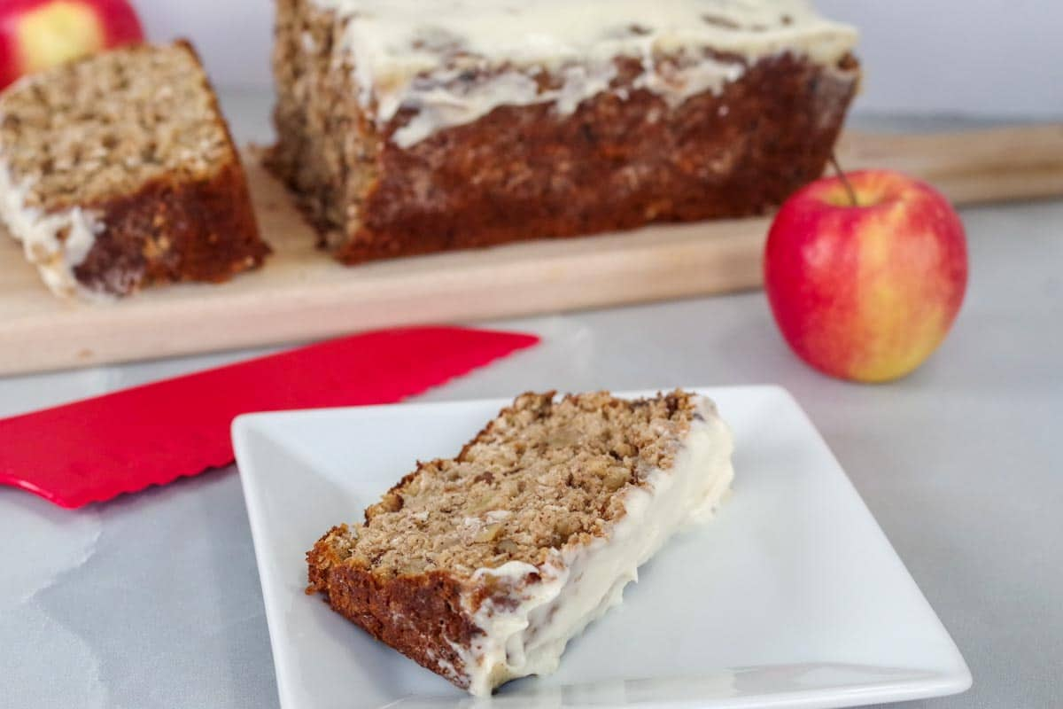 a slice of apple bread on a white plate with a