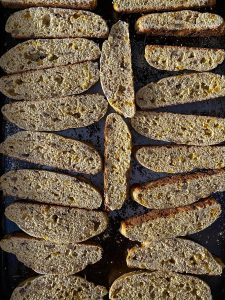sliced biscotti on pan, ready to be baked