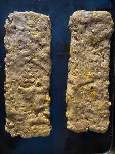 biscotti dough shaped into logs on baking sheet