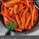 Pinterest pin with white text on grey background on bottom and photo of brown sugar glazed carrots in a black bowl, with a spoon, on grey linen